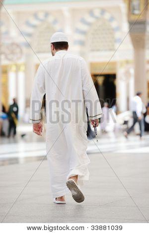 Muslim walking in Medina mosque outdoor