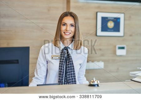Receptionist at hotel front desk