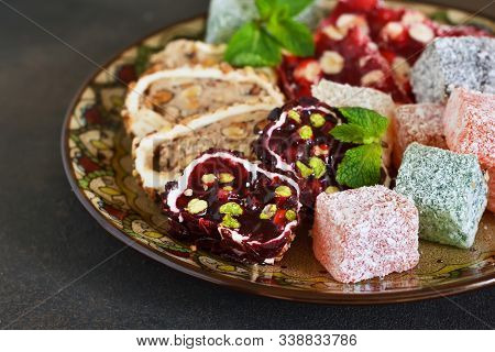 National Turkish Dessert. Plate With Various Pieces Of Turkish Delight Lokum On A Dark Concrete Back