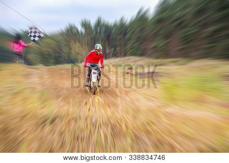Motocross Rider On A Practice Field . Front View Shot Of The Professional Motocross .  Dirt Track.