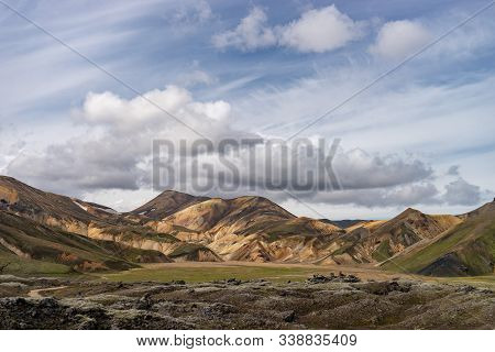Landmannalaugar Valley. Iceland. Colorful mountains on the Laugavegur hiking trail. The combination of layers of multi-colored rocks, minerals, grass and moss poster