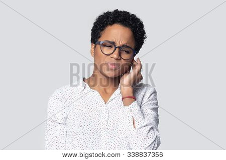 Irritated African American Young Woman Suffering From Strong Earache.
