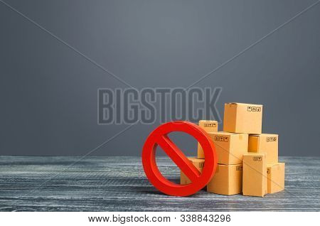 Cardboard Boxes And Red Prohibition Symbol No. Out Of Stock. Embargo Trade Wars. Overproduction Or S