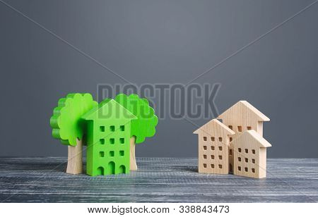 Green House With Trees And Ordinary Residential Buildings. Energy Efficiency, Profitability In Maint