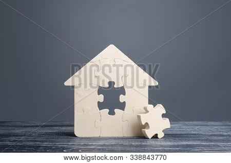 Puzzle House With A Missing Piece. The Acquisition Or Construction Comfortable Dream Home. Mortgage