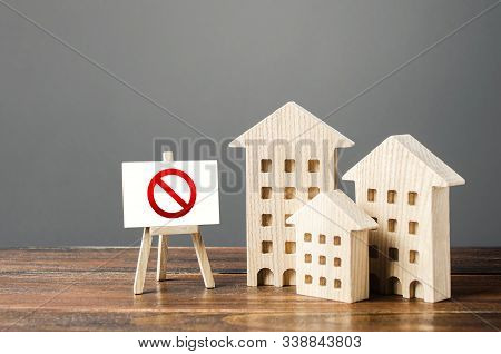Figures Of Residential Buildings And Red Prohibition Sign No. Inaccessible And Expensive Housing. Se