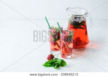 Homemade Fresh Strawberry Lemonade With Basil Leaves On A Dark Background Copy Space.