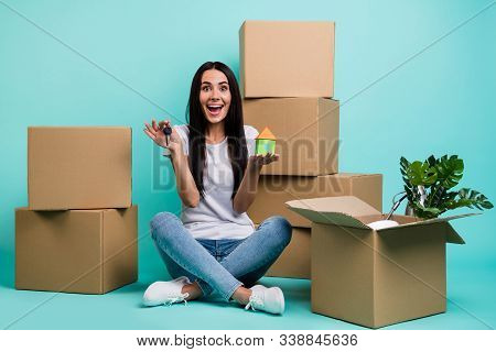 Nice Attractive Ecstatic Cheerful Cheery Girl Sitting In Lotus Pose Holding In Hand House Figure Key