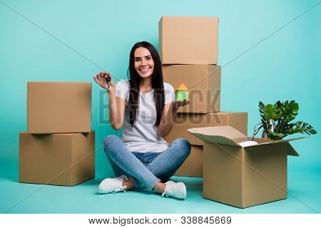 Nice Attractive Cheery Girl Sitting In Lotus Pose With Pile Stack Boxes Holding In Hands House Figur