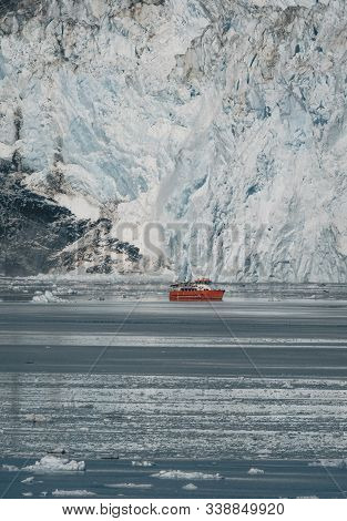 Red Passenger Cruise Ship Sailing Through The Icy Waters Of Qasigiannguit, Greenland With Eqip Sermi