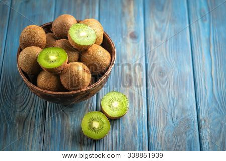 Ripe Fresh Kiwi Fruits In Wooden Box On Rustic Background. Top View With  Copy Space.