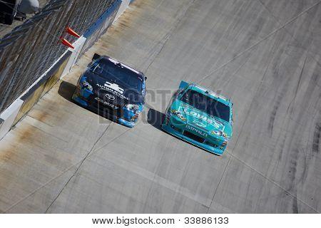 DOVER, DE - JUN 03:  Denny Hamlin (11) races during the FedEx 400 Benefiting Autism Speaks at the Dover International Speedway in Dover, DE on Jun 03, 2012.