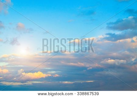 Blue dramatic sky background - sunset dramatic colorful clouds lit by sunlight. Vast sky landscape panoramic scene with rays of light, colorful sky landscape. Blue sunset sky background, sky sunset scene