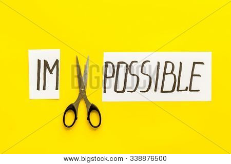 All Is Possible Concept. Cut Word Impossible Near Scissors On Yellow Background