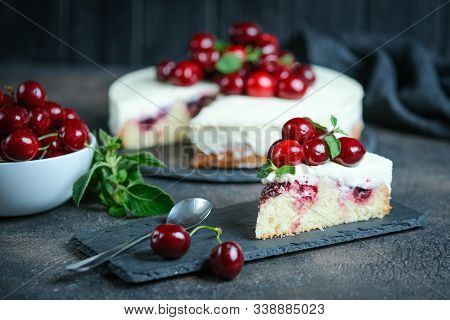 Delicious Homemade Cherry Pie With A Flaky Crust On Dark Background