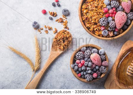 Morning  Granola, Fruits, Berries In Bowl On Grey Concrete Background. Healthy Breakfast Cereals. Co