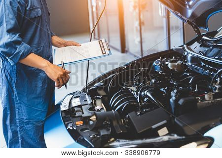 Car Mechanic Holding Clipboard And Checking To Maintenance Vehicle By Customer Claim Order In Auto R