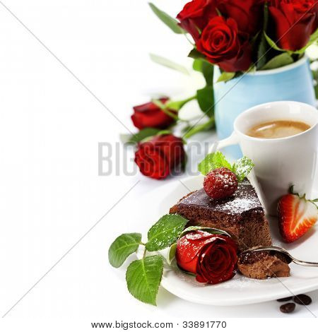 Piece of chocolate cake with coffee and beautiful flowers