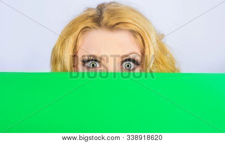 Woman Hiding Behind Billboard. Message Concept. Surprised Woman With Blank Billboard. Blond Girl Pee
