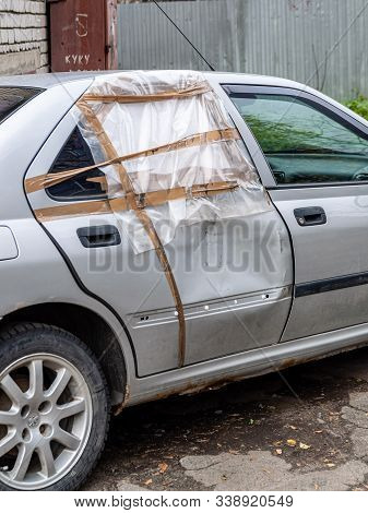 Petrozavodsk, Russia - 24 October 2019. Car With A Dented Door After A Car Accident