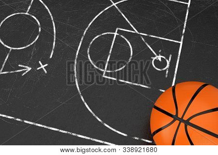 Basketball Tactics Concept. Basketball Ball Over Black Chalkboard With Basketball Court And Game Str