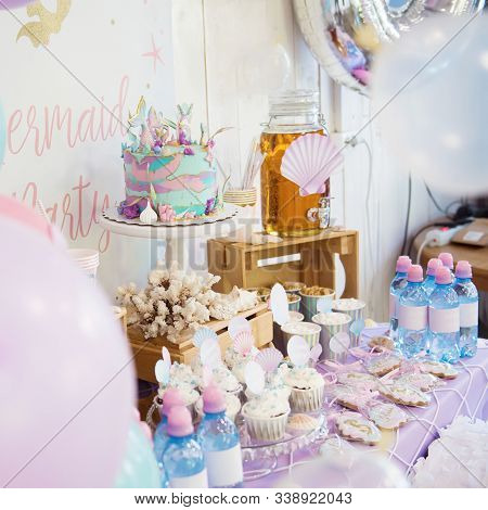 Perm/russia - June, 28, 2019: Mermaid Candy Bar. Delicious Sweet Buffet With Cake. A Beautiful Butte