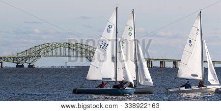 Babylon, New York, Usa - 7 December 2019: Three Small Saiboats Sailing In The Snowflake Regatta In T