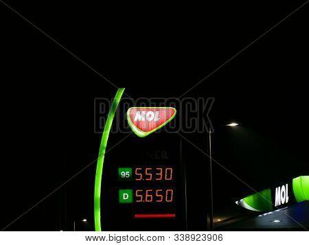 Miercurea Ciuc, Romania- 11 December 2019: Mol Gas Station Street Sign At Night.