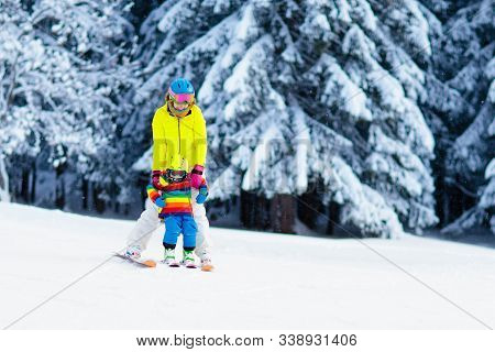 Family Ski Vacation. Group Of Skiers In Swiss Alps Mountains. Mother And Child Skiing In Winter. Par