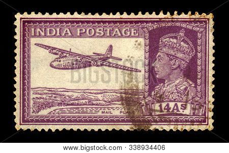 India - Circa 1940: A Stamp Printed In India Shows A Portrait Of An King George Vi And Mail Plane, C