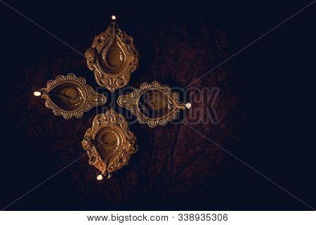 Diwali Beautiful Diya Lamp Lit And Arranged On Floor