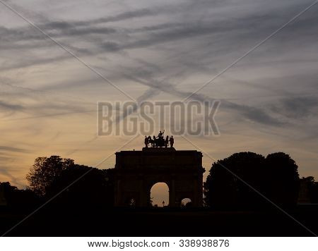 Arc De Triomphe Du Carrousel Near The Louvre In Paris In Silhouette Against A Twilight Sky Covered I