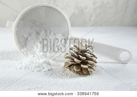 Christmas Decoration Cone Covered Snow Made Of Icing Sugar With Sieve. Christmas Forest Concept. Gol