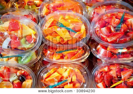 Colorful natural fruit salad transparent glasses in a row