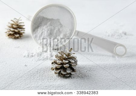 Christmas Decoration Cones Covered Snow Made Of Icing Sugar With Sieve. Christmas Forest Concept. Go