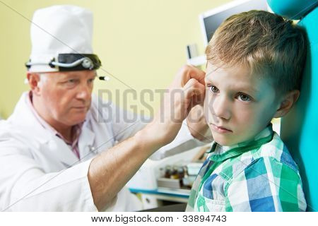 Medical otitus examination of a little child at a ear nose throat doctor