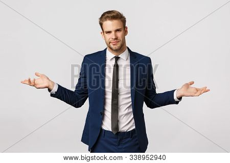 I Dont Know. Unsure And Puzzled Handsome Businessman With Bristle, Blond Haircut, Wear Suit, Spread