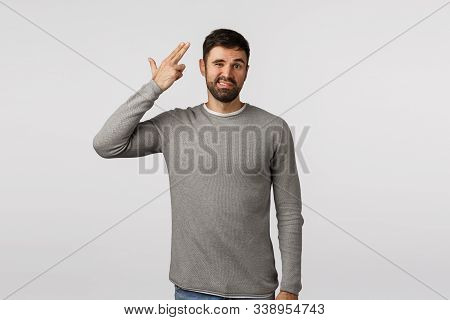Kill Me Please. Bothered And Tired, Annoyed Attractive Caucasian Bearded Man In Grey Sweater, Shooti