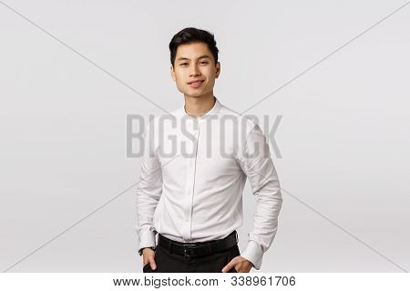 Business, Success And Wellbeing Concept. Handsome Young Asian Businessman Working With Finances, Hav