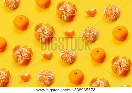 Mandarin Pattern On A Yellow Or Orange Background, New Year And Christmas Concept, Peeled Tangerines