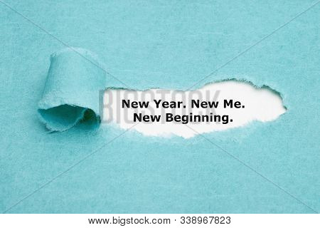 Motivational Self Encouragement Quote New Year, New Me, New Beginning Appearing Behind Torn Blue Pap