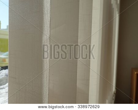 Interior Vertical Jalousie Hanged On A Window
