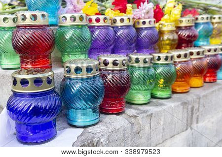 Colorful Candles On The Parapet At The Monument