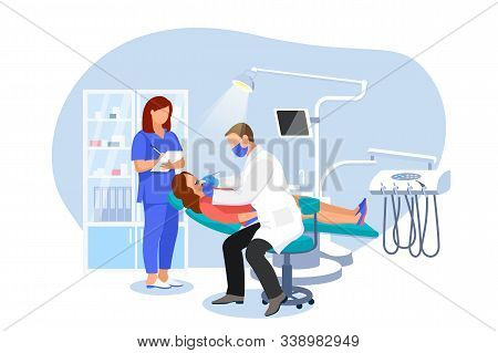 Dentist Doctor And Nurse Or Examines A Patient In Dentist Chair. Woman Visits Orthodontist At Modern