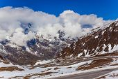 Grossglockner sightseeing road - the famous panoramic road in Austria, runs through the Hohe Tower Park. The first snow fell in September. Ecological, active and photo tourism concept poster