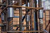 Fittings interconnected by a nut at a construction site. The technology of splicing two metal rods. poster