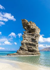 Photo Of Iconic Beach Of Grias Pidima Near Village Of Korthi, With Rare Geological Rock And Turquois