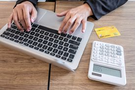 Businesswoman Using Laptop And Holding Credit Card For Paying Detail Page Display Online Shopping Pu
