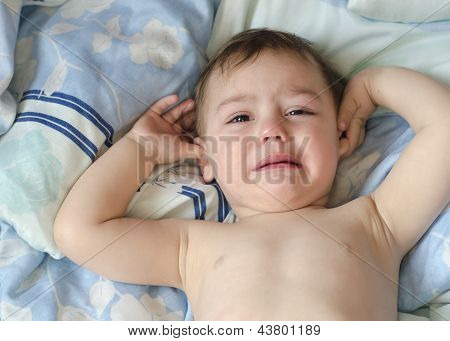 Baby or todler crying in the bed. poster