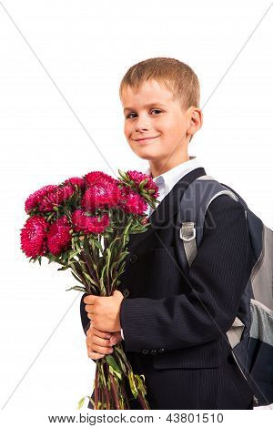 Schoolboy Is Holding Flowers. Back To School